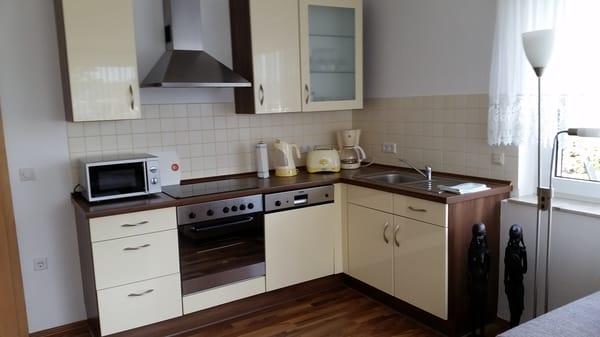 Wohnzimmer + offene Küche