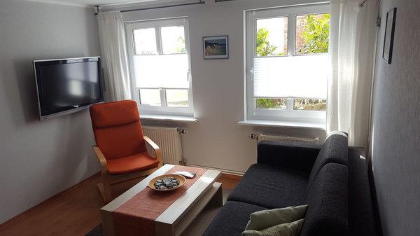 Gemütliches Wohnzimmer mit ausziehbarer Schlafcouch, Aufbettung für max. 2 Personen/ Kinder gegen Aufpreis möglich
