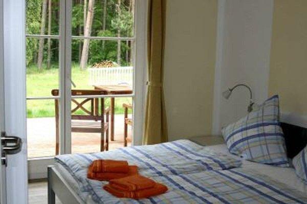 Schlafzimmer 2 mit Doppelbett und Ausgang zu IhrerTerrassentür
