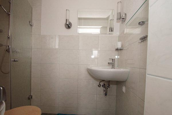 Der Sanitärbereich - Dusche, Waschbecken, WC