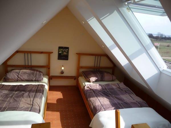 Schlafempore Dachgeschoss mit Panoramafenstern