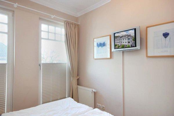 Schlafzimmer mit zusätzlichem TV
