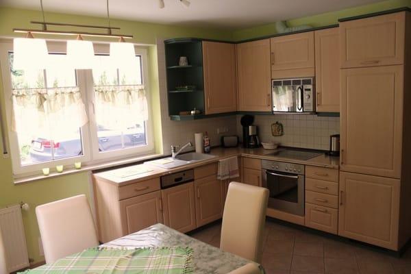 Die toll eingerichtet Küche von dort können Sie direkt auf die Terrasse gehen