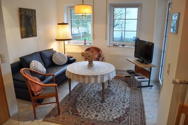 Wohnbereich der Ferienwohnung mit zusätzlichem Schlafsofa für 2 Personen