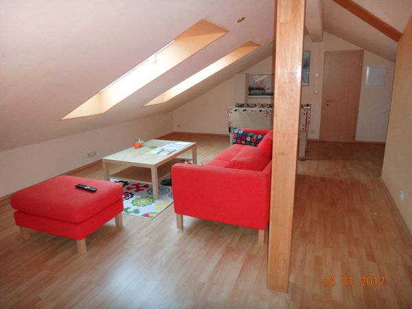 Wohnstube mit 2 Sitzecken und Kickertisch