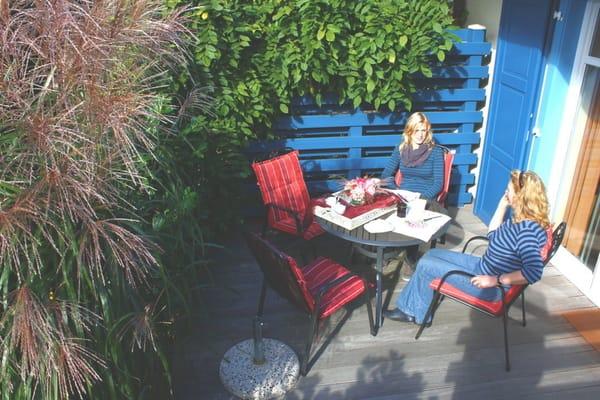Terrassen mit Holzbelag und Grill, Terrassentür als Hebeschiebetür Bild: 5*Reihenhaus Nordstrand