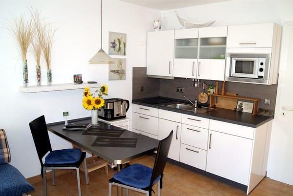 Studio mit Terrasse zum Park und moderner Küche