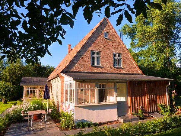 Blick auf die Ferienwohnung mit Veranda und Terrasse
