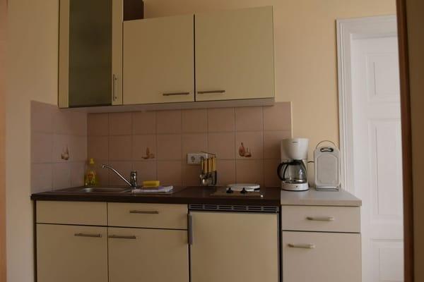 Küche mit sonnigem Südbalkon