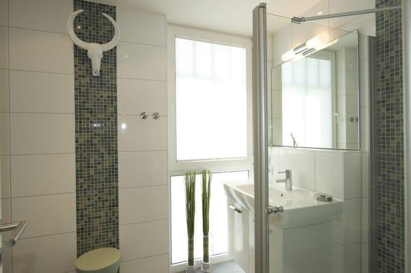 Das exklusive Badezimmer mit Tageslicht und