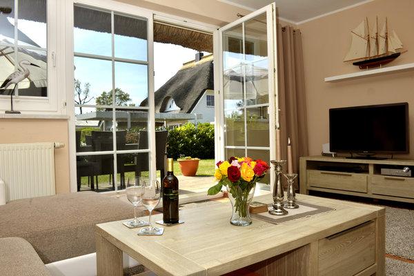Wohnzimmer mit Ausgang zur Terrasse