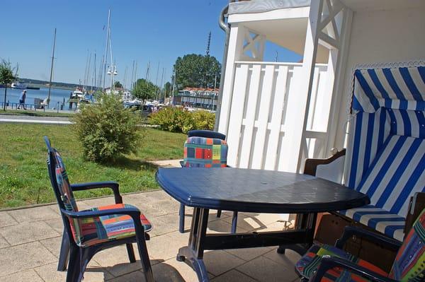 Ferienwohnung Hafenidyll Nr. 40 - Sonnenterrasse mit Strandkorb