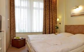 Hier können bis zu 4 Personen übernachten, mit Kinderbettaufbettung bis 3 Jahren sogar 5 Personen. Zusätzlich bieten beide Schlafzimmer ein Flat-TV.