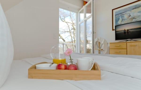 Vom Schlafzimmer haben Sie ebenfalls Zugang zum Balkon.