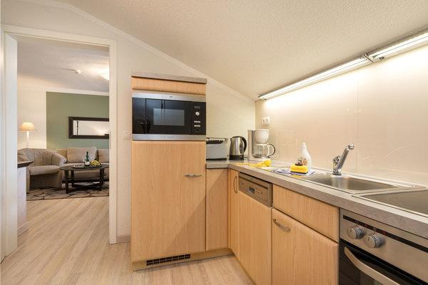 Hier ein Blick in die Küche. Der Eßtisch befindet sich im Wohnzimmer.