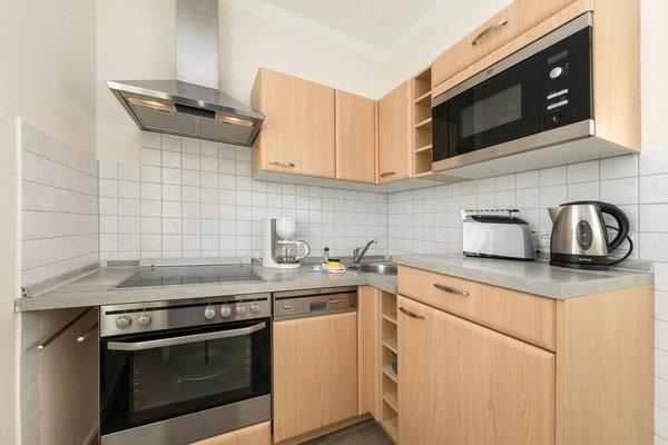 Hier der Blick in die kleine separate Küche. Der Eßbereich befindet sich im Wohnzimmer.