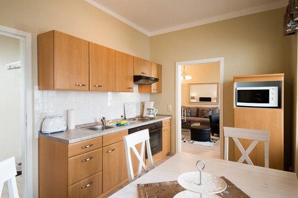 Die separate Küche ist für Sie komplett ausgestattet.