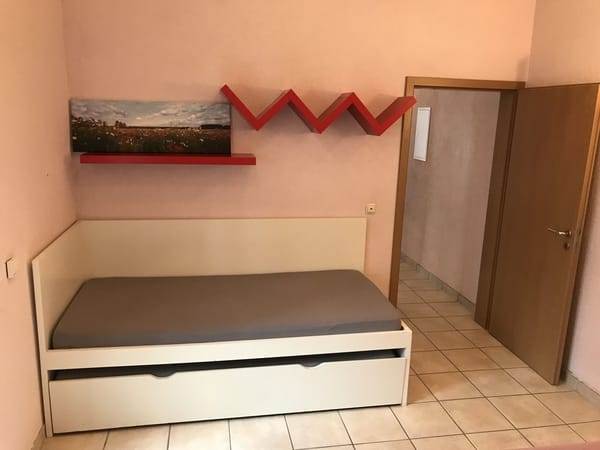 Bett mit ausziehbarem Unterbett
