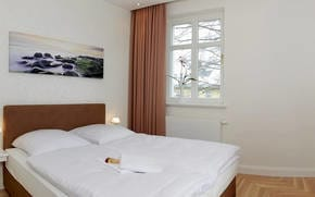 Eines der beiden Schlafzimmer verfügt sogar über einen direkten Zugang zum Balkon, welcher zum Entspannen und Träumen einlädt.