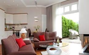 Der moderne Wohnbereich mit Gaskamin und Flat-TV lädt zum Verweilen ein.
