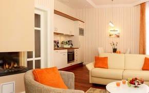 Das Interieur des Wohn- und Kochbereichs ist modern und gemütlich zugleich.  Die integrierte luxuriöse Küchenzeile lässt keine Wünsche offen.