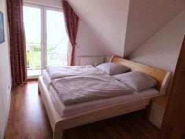 1. Schlafzimmer mit Balkon