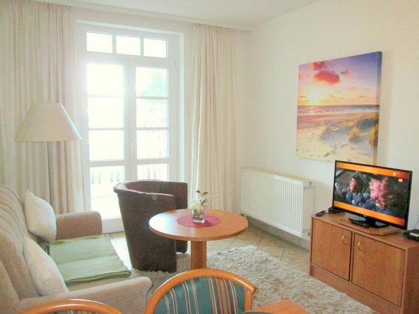 Wohnraum mit ausziehbarem Schlafsofa Richtung TV