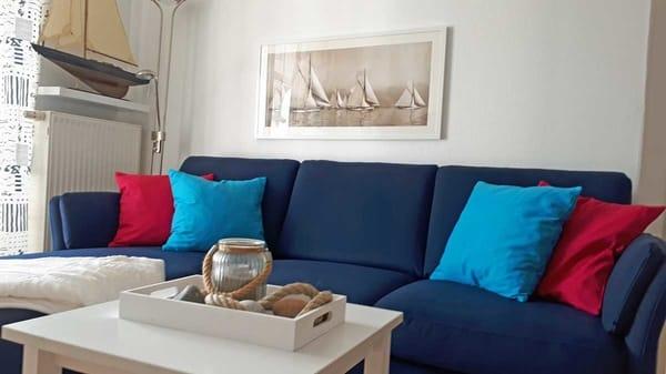 Sitzecke im Wohnzimmer mit ausziehbarem Sofa