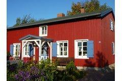 Bild: Rotes Haus am Barther Strom