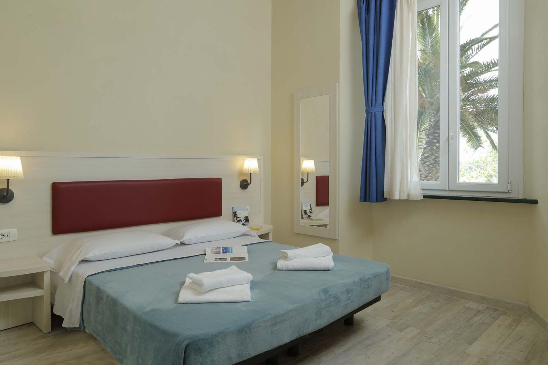 Camera da letto Hotel Mulinaccio al camping village in Toscana
