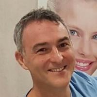 Dr. Mario Baviera