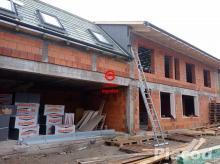 Eladó igényes kivitelezésre váró 114 m2-es új építésű ikerházi lakás saját kerttel Vácon.