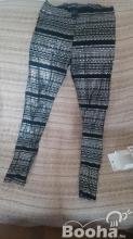 Új M-es méretű H&M női fémes mintájú leggings eladó