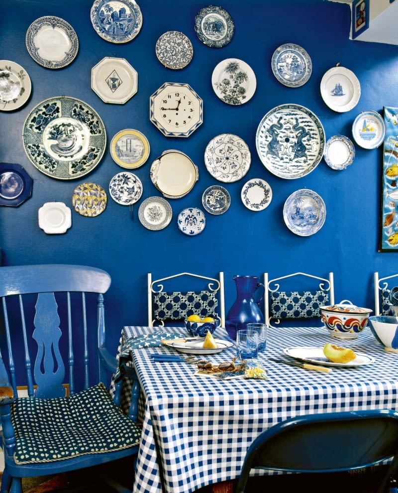 Modern blue dining room table chairs check pattern cloth ceramic wall plates interiors rooms cool colours display collections