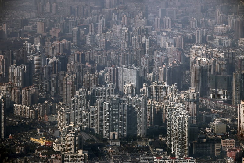In this Dec. 7, 2010 photo, an aerial view of new residential area is seen in Shanghai, China. The country's commercial capital will impose a limited property tax to help curb surging prices, Shanghai's mayor says, describing good handling of housing as crucial for the city's future. (AP Photo/Eugene Hoshiko)