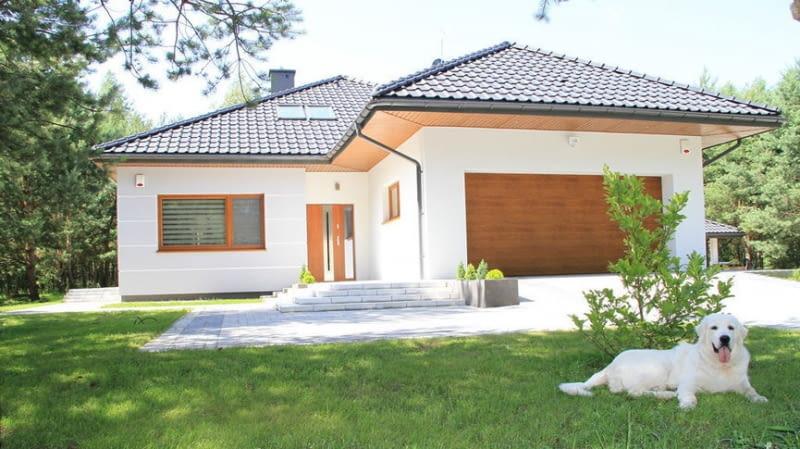Dom idealnie wpisuje się w aktualne trendy, łącząc modny wygląd zewnętrzny...