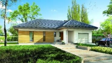Dom z garażem w bryle - zajmuje mniej miejsca na działce niż dwa osobne budynki i jest wygodniejszy dla domowników, bo garaż można łatwo połączyć z resztą domu