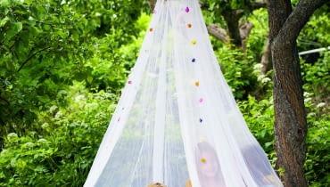 ACCYBH Girls under a mosquito net.