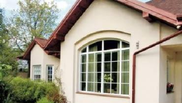 łukowe nadproża,nadproża,dom jednorodzinny,okno łukowe,okna,okno