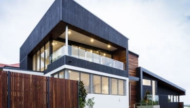 (New stylish modern home exterior at duskC%#