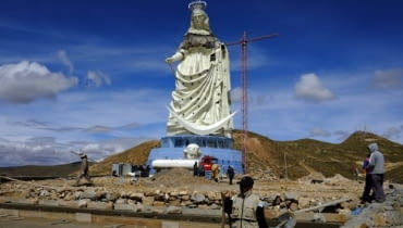 People work at the base of the Virgin of the Socavon (patron saint of miners) statue during its construction at the Santa Barbara hill in the outskirts of the Oruro, some 200 km (124 miles) south of La Paz, January 18, 2013. The statue measures 45 metres (148 feet) in height and stands at 3850 meters (12,631 feet) above sea level. The statue is expected to complete by February 2, 2013 according to its sculptors. REUTERS/David Mercado (BOLIVIA - Tags: RELIGION SOCIETY)