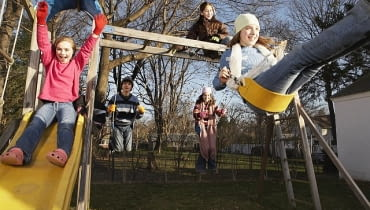 Children Playing in Playground --- Image by Stephen Mallon/Corbis