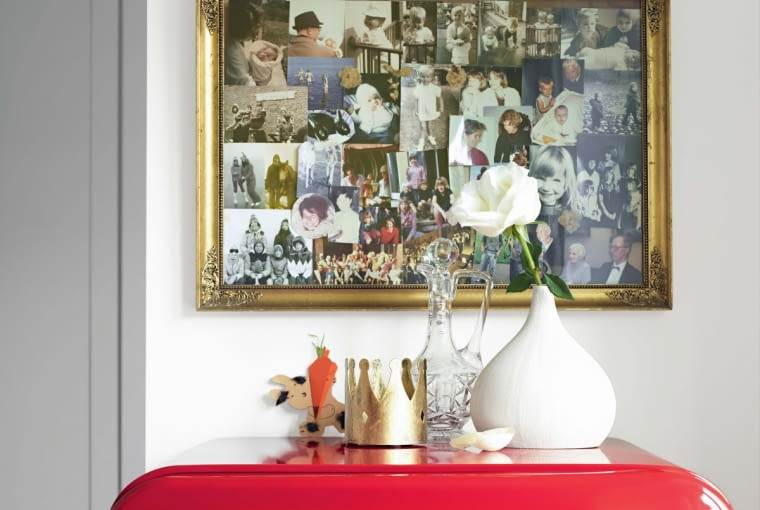 WVarious photographs in golden frame and crown, vases and decorative on retro red fridge