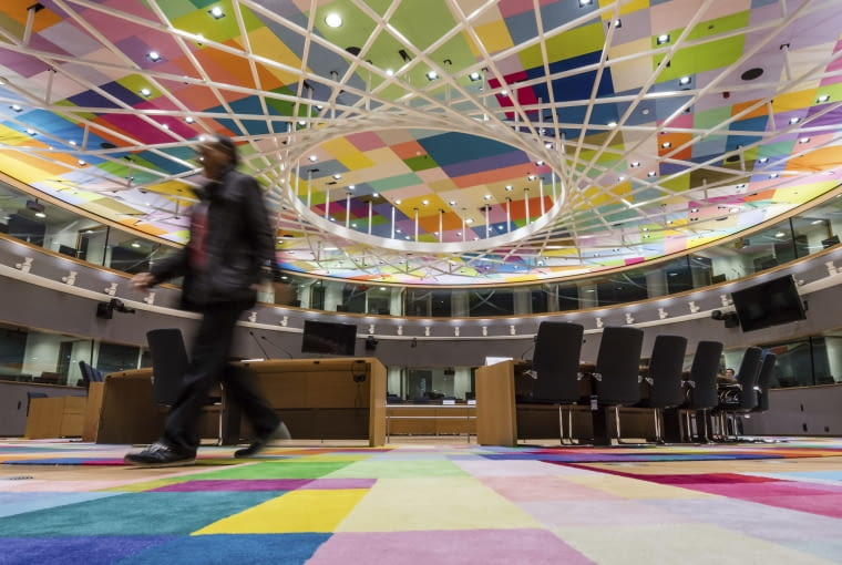 A man walks inside the main meeting room at the Europa building in Brussels on Friday, Dec. 9, 2016. From the beginning of 2017, the Europa building becomes the home of the two institutions representing the EU member states: the Council of the European Union and the European Council. (AP Photo/Geert Vanden Wijngaert)