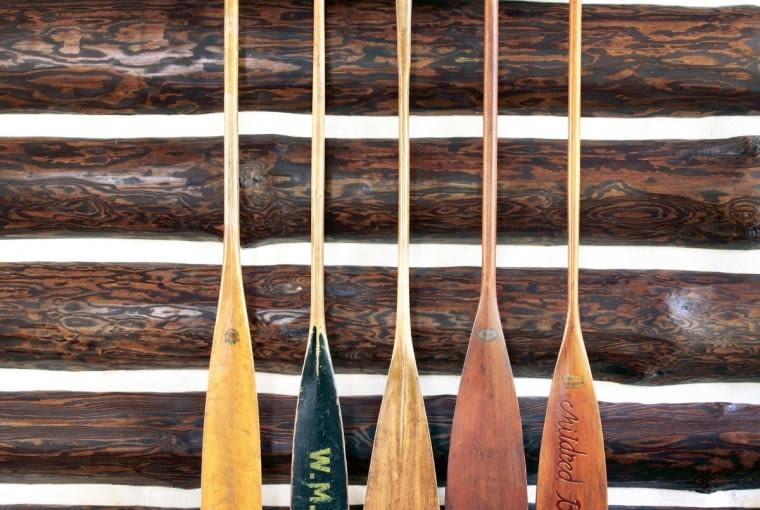 Wooden oars on log cabin wall