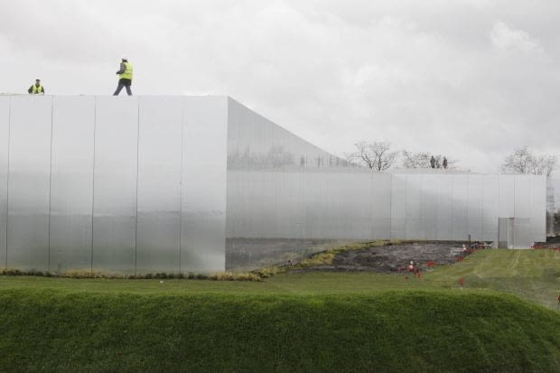 Workmen prepare the site of the Le Louvre Lens Museum, by Japanese architects Kazuyo Sejima and Ryue Nishizawa, on the eve of the inauguration of the museum in Lens, northern France, December 3, 2012. MANDATORY CREDIT Architects Kazuyo Sejima + Ryue Nishizawa SANAA REUTERS/Pascal Rossignol (FRANCE - Tags: SOCIETY TPX IMAGES OF THE DAY)