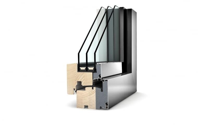 Propozycja 2. System: HF 310, okna drewniano-aluminiowe, profil z drewna świerkowego, pianki termoizolacyjnej oraz zewnętrznej nakładki aluminiowej o grubości 85 mm; Uf = 0,86 W/(m2K) Pakiet szybowy: dwukomorowy; Ug = 0,5 W/(m2K), g = 54%; Uw = 0,69 W/(m2K) Cena: 32 799 zł