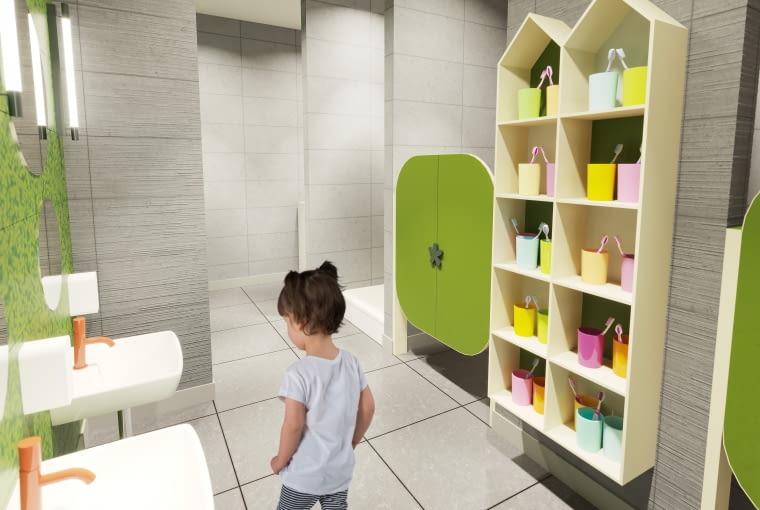 Żłobek w Czernikowie - łazienka obok sypialni. Proj. M&R Biuro Projektów