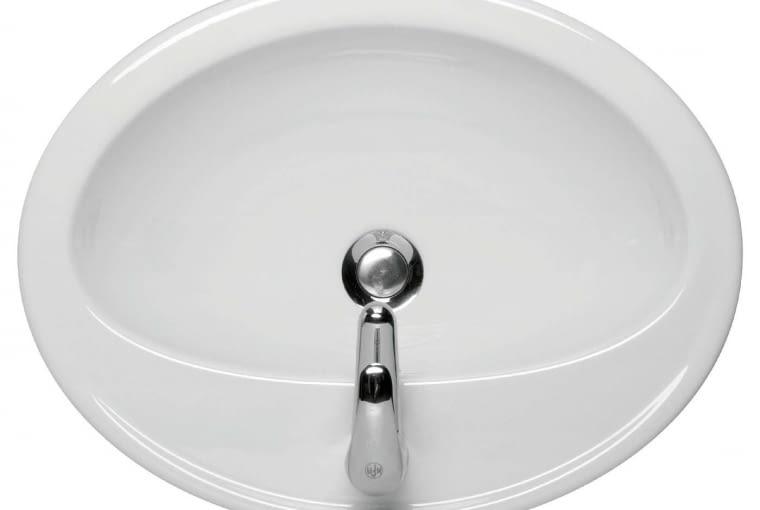 Calla/CERSANIT. Umywalka ceramiczna nablatowa o zaokrąglonym kształcie; w zestawie znajduje się szablon ułatwiający wycięcie otworów montażowych; wymiary: szer. 53,5 cm, gł. 41 cm. Cena: 279 zł, www.cersanit.com.pl