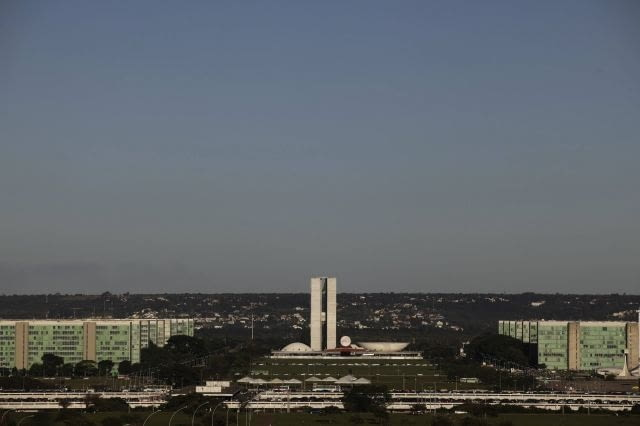 The Esplanada do Ministerios and the Brazilian National Congress (background) are seen in Brasilia April 7, 2010. The dream was big. In just a few years, Brazil would build a modern capital in the middle of a savanna, an experiment in egalitarianism that would also shift power toward the center of the vast country. As Brasilia turned 50 years old on April 21, 2010, vestiges of that dream live on in Oscar Niemeyer's soaring architecture, the uniform residential apartment blocks, and the plane-like city shape that legend has it was meant to signal the Latin American giant's take-off. Picture taken April 7. To match Feature BRAZIL-BRASILIA/ REUTERS/Ricardo Moraes (BRAZIL - Tags: ANNIVERSARY CITYSCAPE)